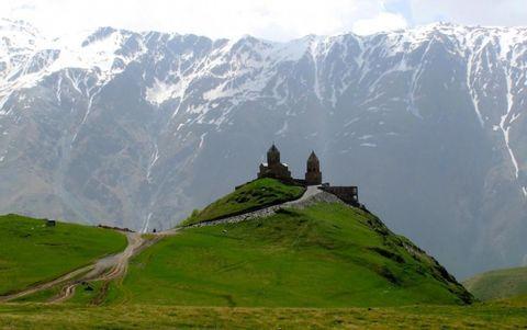 Gergeti Trinity Church & The Caucasus Mountain Peaks