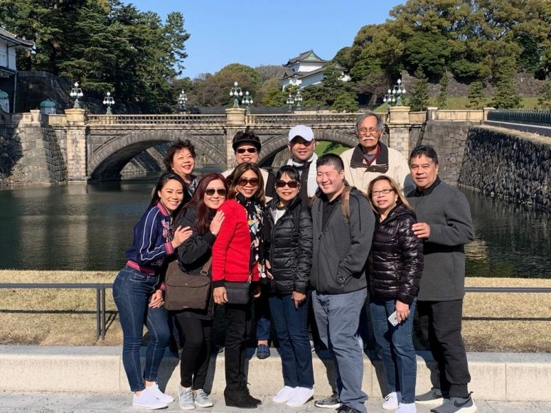 Cheerful group at Imperial Palace Plaza.