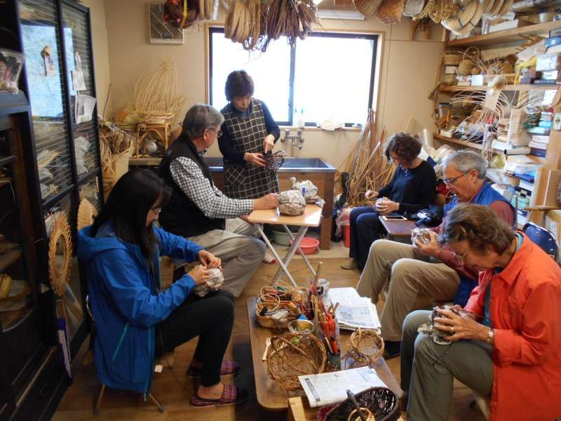 I am giving a basketry workshop to tourists from the US. They are learning traditional Japanese skills to make baskets.