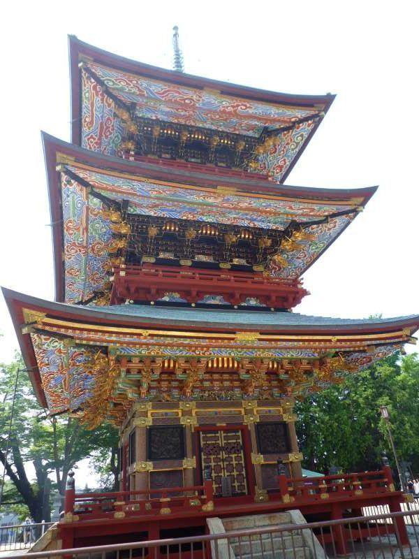 dreistoeckige Pagode.  Ein buddhistischer Turm ist mit ungerade Zahl-Daecher, weil eine ungerade Zahl als glueckverheissend gilt.