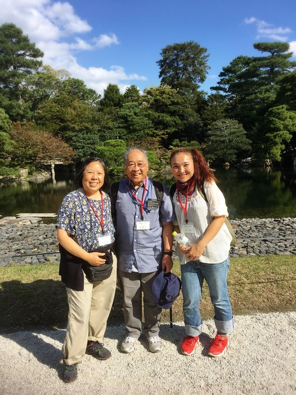 Kyoto imperial palace with enegetic senior couple Lanette and Norman from USA