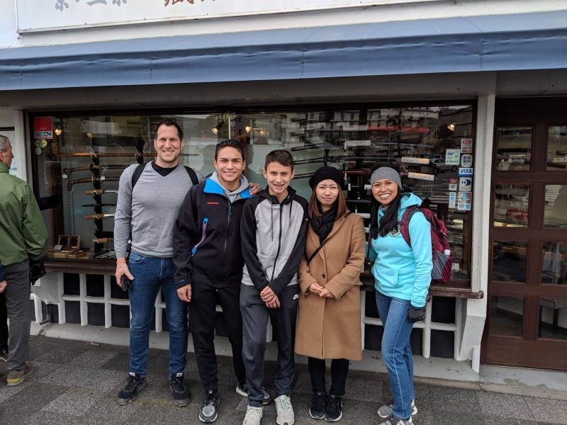 What a beautiful family! We took a picture in front of a Japanese sword shop.