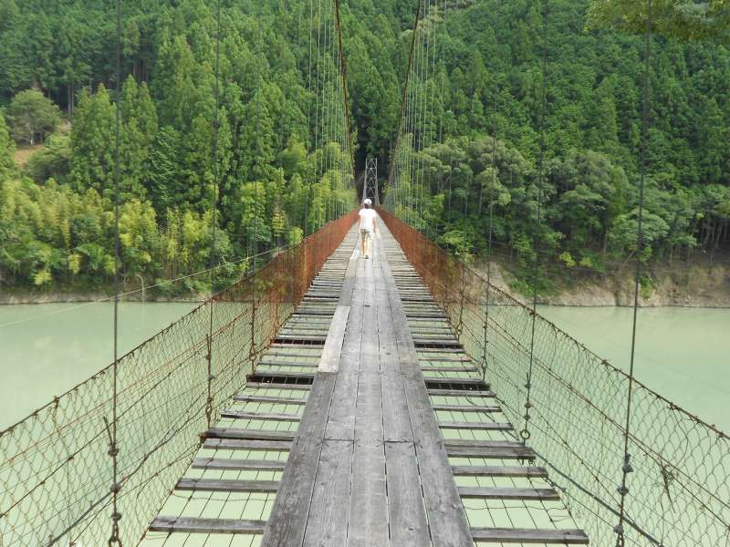 "A suspension bridge on ""Futatsuno"" dam lake. All of these bridges were built for the lifeline for local people. Today very few people use the bridge. So some are broken some are rotten so they are very thrilling."