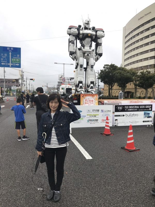 at a special event in front of Hashima Shinkansen bullet train station with a big robot, Mobile Police Patlabor