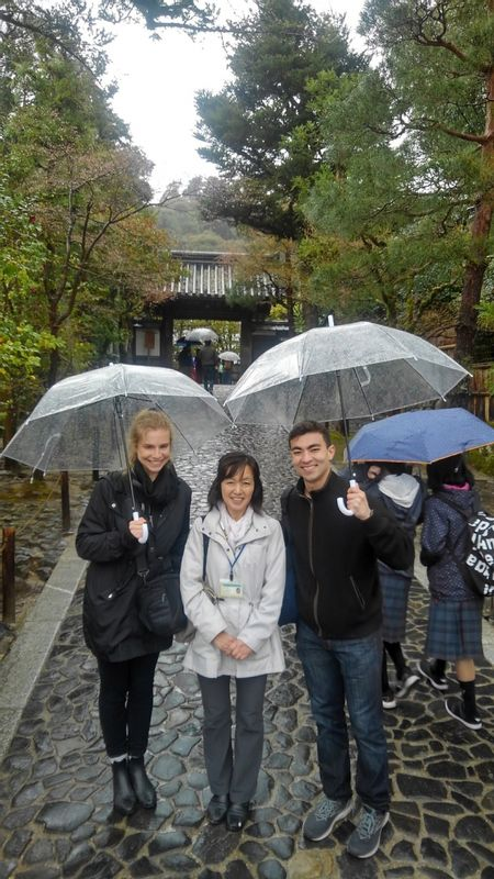 in front of Ginkakuji Temple with my guests( Ginkakuji temple is so nice place to visit even on rainy day)