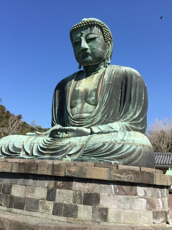 In Kamakura 50km south-west of Tokyo,  Great Buddha Statue sitting in the open air