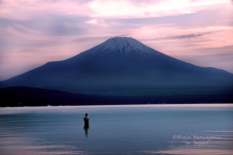 Fuji's majesty and single fisherman
