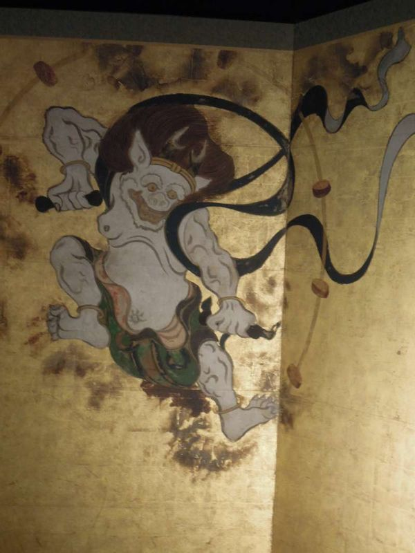 Thunder God of Fujin-Raijin zu Byobu ( folding screen ) painted by Tawaraya Sotatsu, housed by Ken-ninji Temple near Gion  ( a reproduction photographed by a Canon camera equipped with the cutting-edge technology )