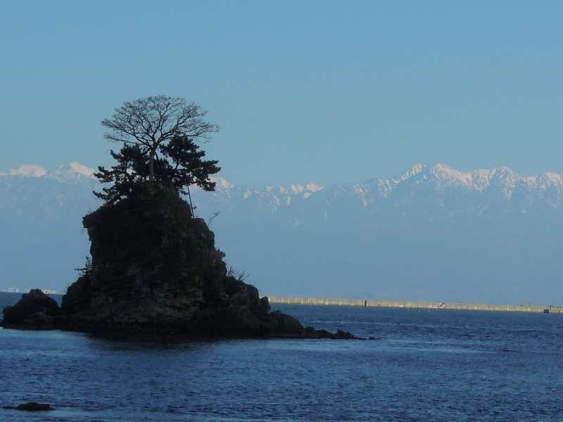 A view of snow-capped Tateyama Mountain Range from Ame-harashi Seashore, Toyama Prefecture