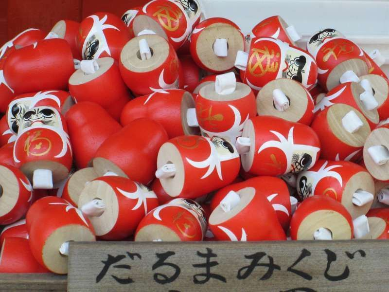 Why don't you try a  daruma doll fortune strip at Hanimisaki Shrine?