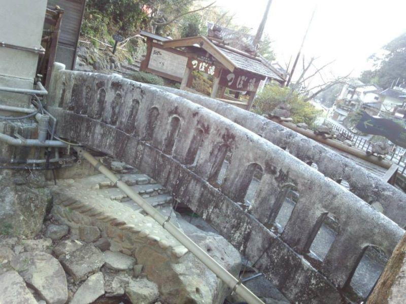 "The stone bridge by the World Heritage hotspring ""TSUBOYU"""