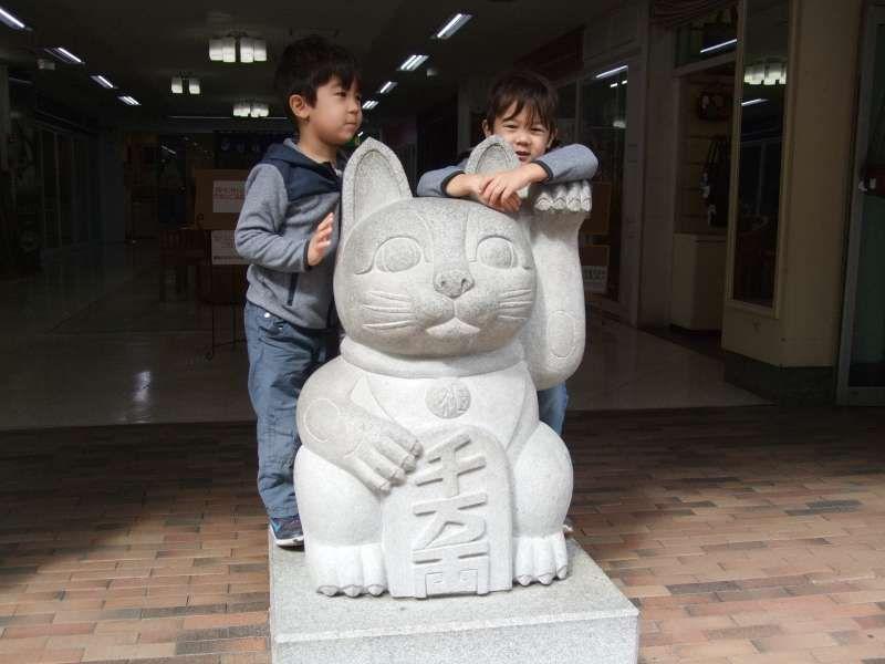 A little bit taller than the beckoning cat!