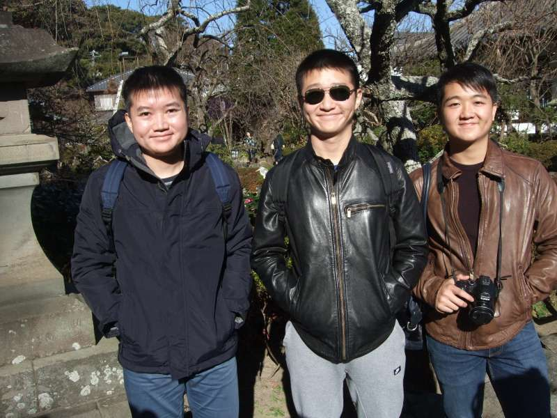 Three brothers with the beautiful garden in the back at Hase Temple
