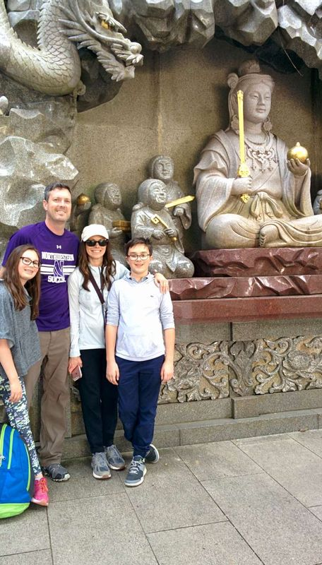In front of a big relief of a sea goddess and a dragon at Enoshima Shrine