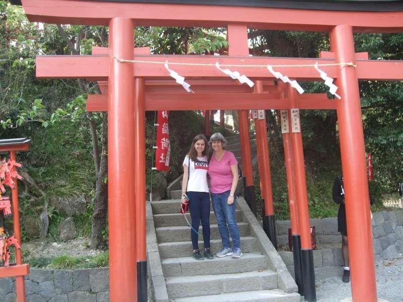 Under the red torii gates of Maruyama Inari Shrine at Tsurugaoka Hachiman Shrine