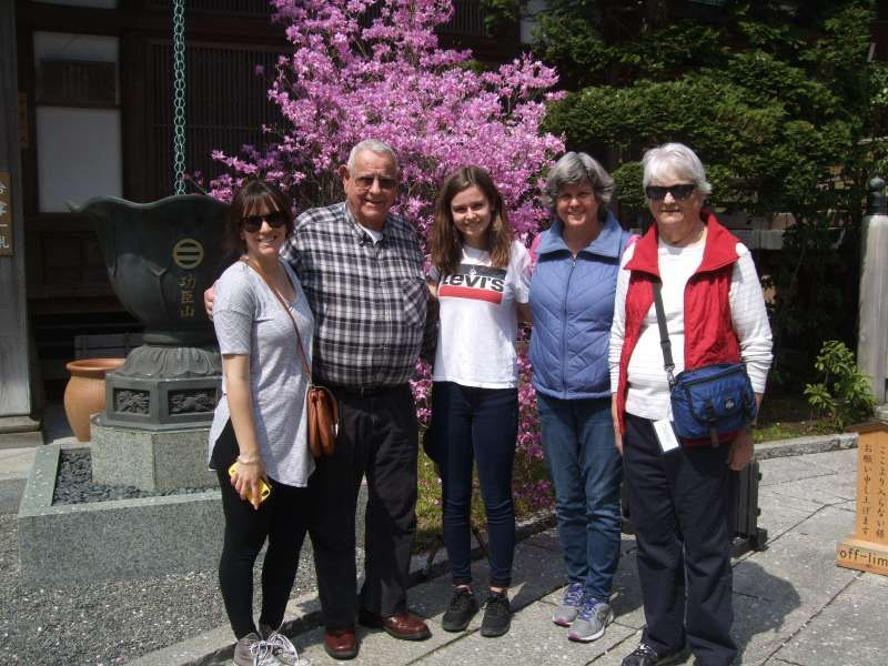 With the beautiful azalea in front of the main hall of the Bamboo Temple