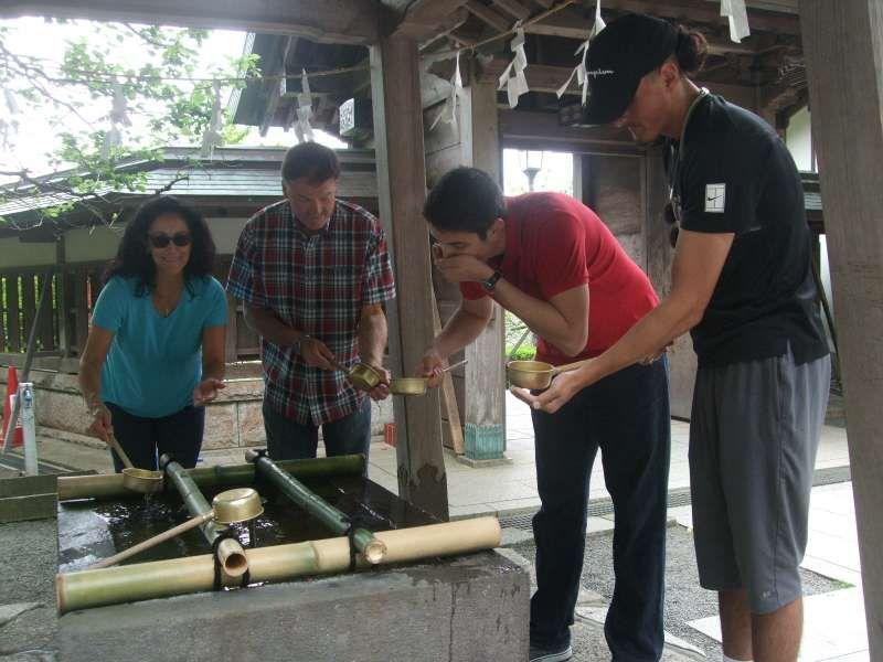 Purification at a hand-washing basin at Egara Tenjin Shrine