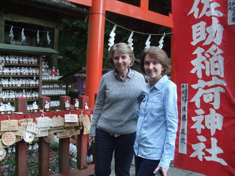 Amazed at  those so many small statues of white foxes at Sasuke Inari Shrine