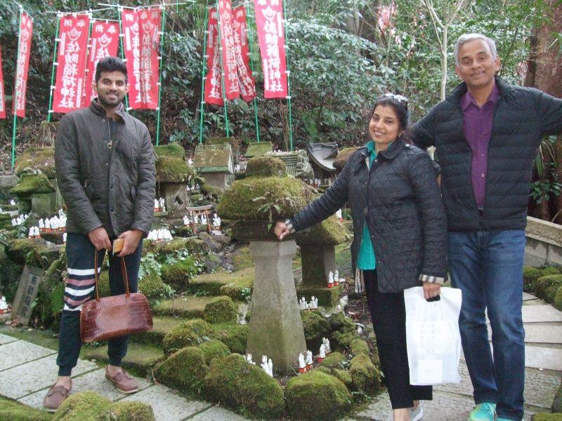 With those countless small fox statues at Sasuke Inari Shrine