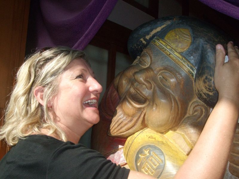 Giving Daikokuten, a happy god, a big hug for good luck