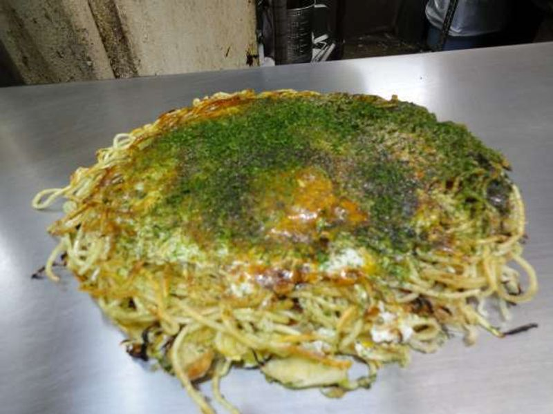 Okonomiyaki ....Soul food in Hiroshima! Affordable price and fun to eat. 