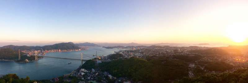Panorama sunset view from Shimonoseki side. There is a mountain called