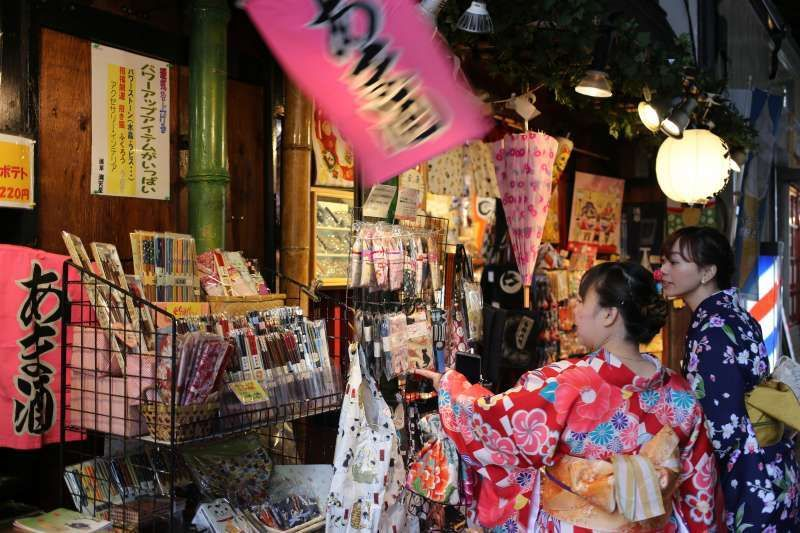 Young Ladies in Traditional Kimono shopping in Asakusa, Tokyo. You do not have to go to Kyoto or Nara to see women in colorful kimono costumes.