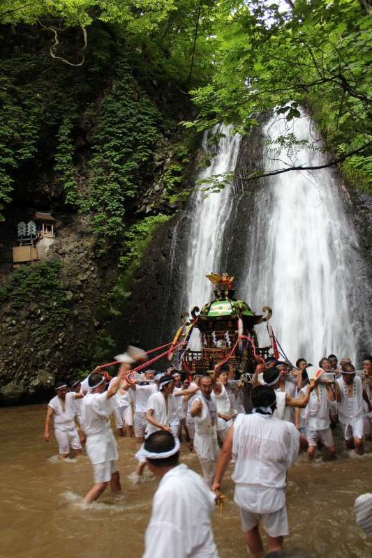 Shirataki Jinja Shrine, Happouchou, Akita.  `Portable shrine of feudal load Satake's (which the descendant is the present mayor of Akita Prefecture) goes into waterfall on August 1.