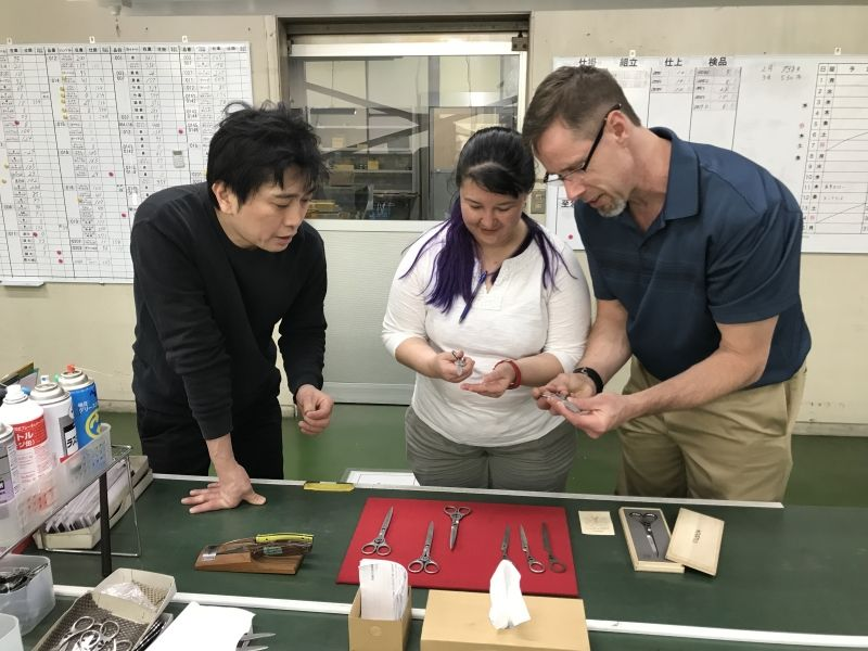 An American couple enjoying an excursion of the knife factory in Seki