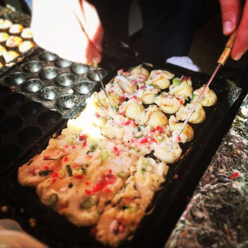 How about trying making takoyaki at a takoyaki stand ??