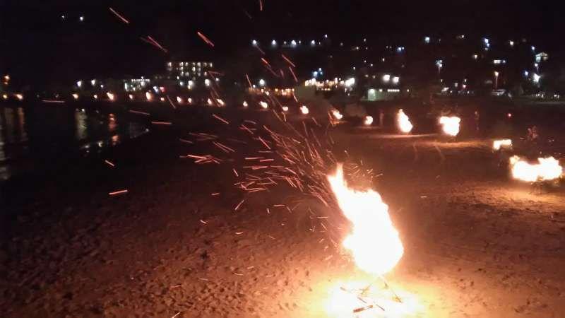 Bonfires at Taga Bay on obon day in Aug.