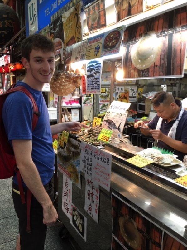 Strolling through Kuromon Food Market near Dotombori downtown Osaka