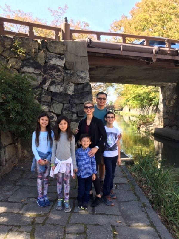 Lovely family strolling along a quiet canal in Ohmi-hachiman city, near Lake Biwa, in Shiga Prefecture