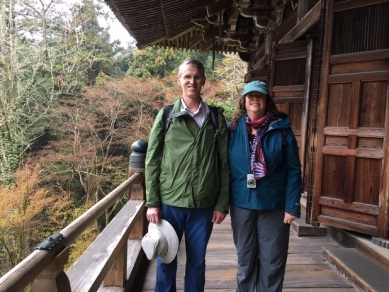 Cozy couple standing at the expanded veranda of a mail hall of Shoshazan Engyoji Temple which was ranked #20 out of top 30 attractions in Japan by international travelers by Trip adviser, 2019.