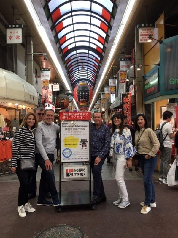 Cheerful couples at Osaka Kuromon Food Market