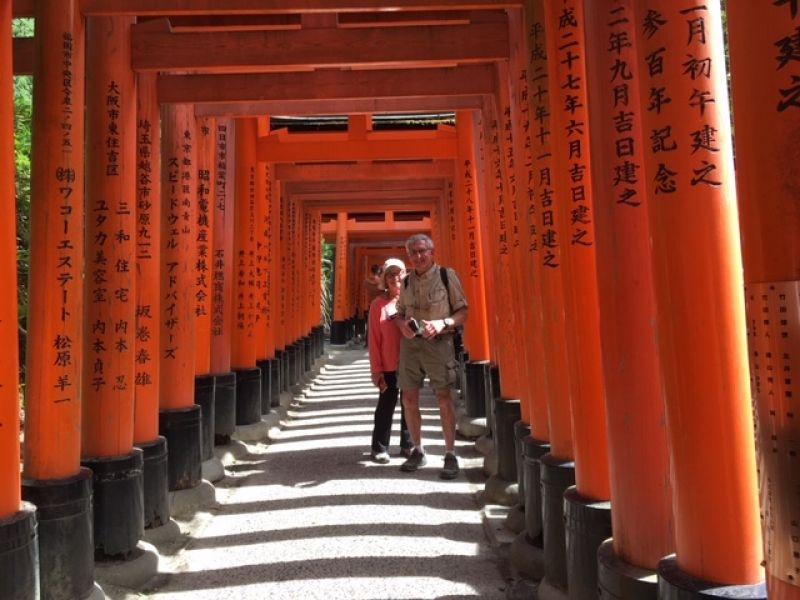 Lovely couple with Torii shrine gates at Kyoto's Fushimi Inari Shrine which is dedicated to the god of