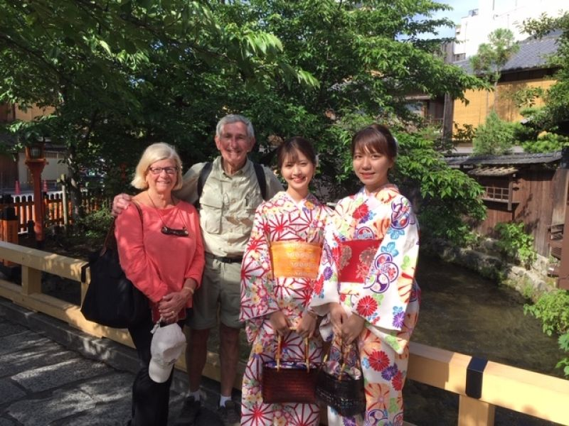 Nice couple with kimono clad women at Kyoto's Gion Shirakawa which still retains Maiko's traditional culture among others