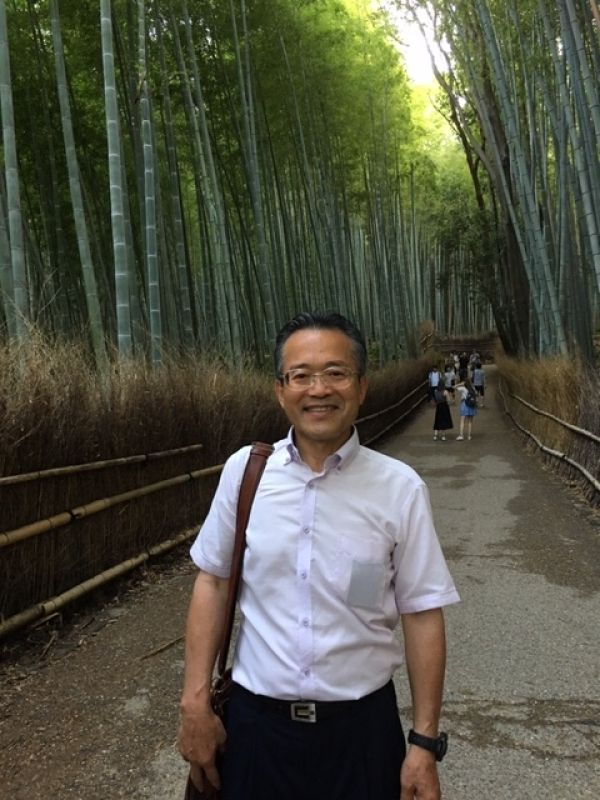 I'm here, 100%, to HELP you explore Japan.:) (Note: I had this picture taken by a teenaged wannabe professional photographer at Kyoto's Arashiyama Bamboo Forest. I'm sure I look cool!?)