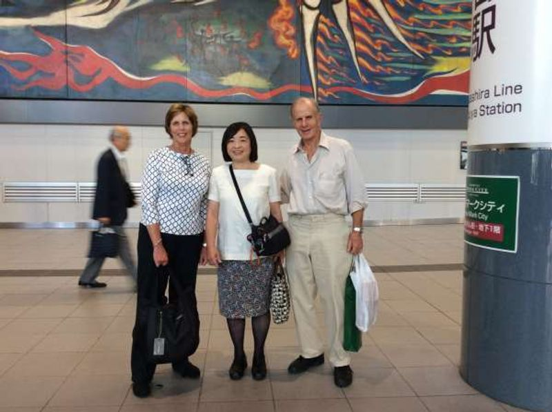 """This is me with a couple from the US traveling throughout Japan. We are in front of Taro Okamoto's masterpiece: """"Myth of Tomorrow"""" in Shibuya."""
