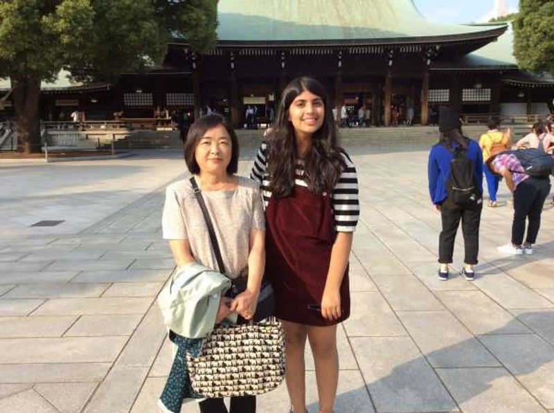 This is me with a young lady from the UK. She was traveling with her father.  It was nice to see them getting along so well. We are in the Meiji shrine. Meiji shrine is one of the most popular sightseeing spots in Tokyo.