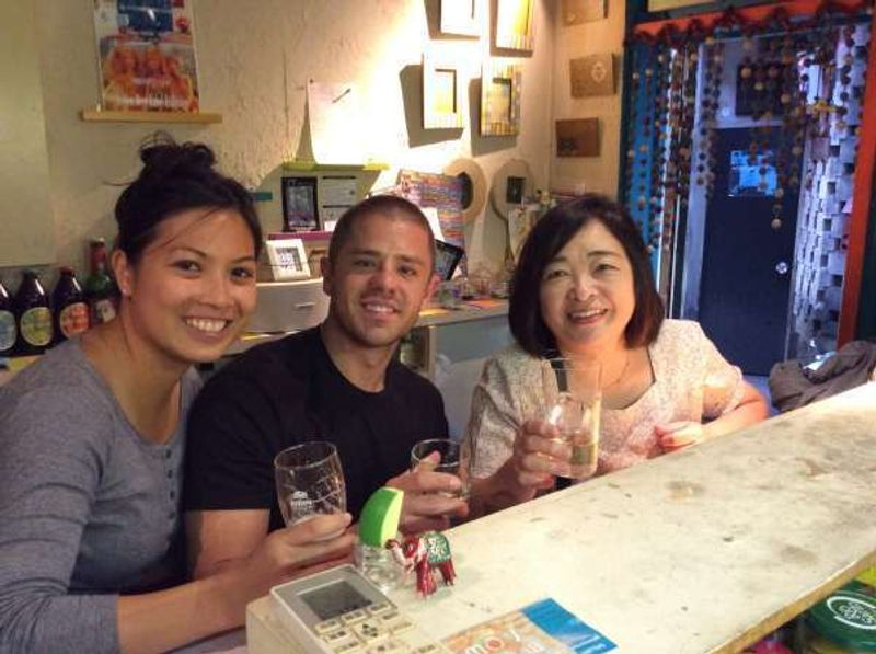 This is me with a young couple from Texas. We went to the Imperial Palace and coincidentally saw the Emperor and Empress. They wanted to go to Shinjyuku Golden Gai! Here we are! We gave a toast and had fun together!