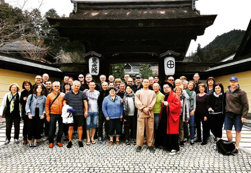 A photo in front of Buddhist temple