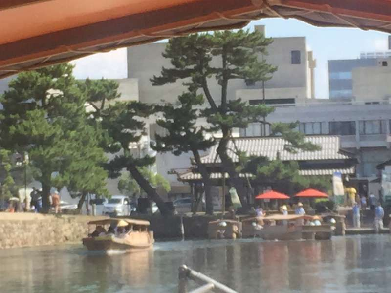 Horikawa Boat Ride - has a roof which goes down very low under passing through low bridges.  It's fun!!