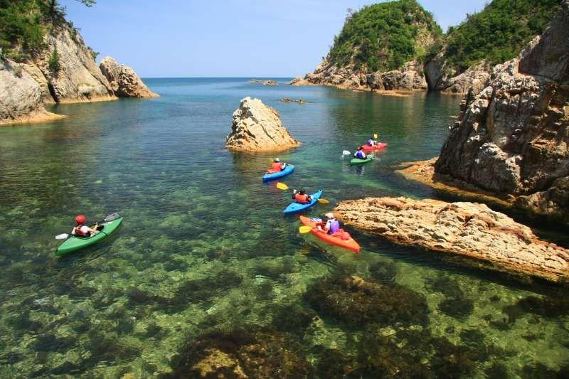 Enjoying kayak touring. Uradome sea coast