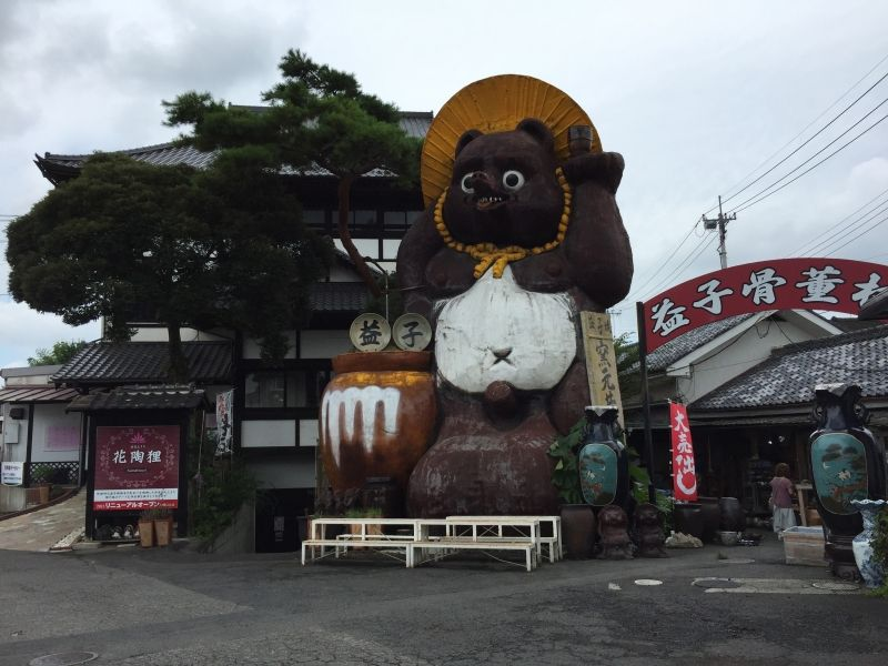 a statue of a Japanese raccoon the symbol of the Mashiko town