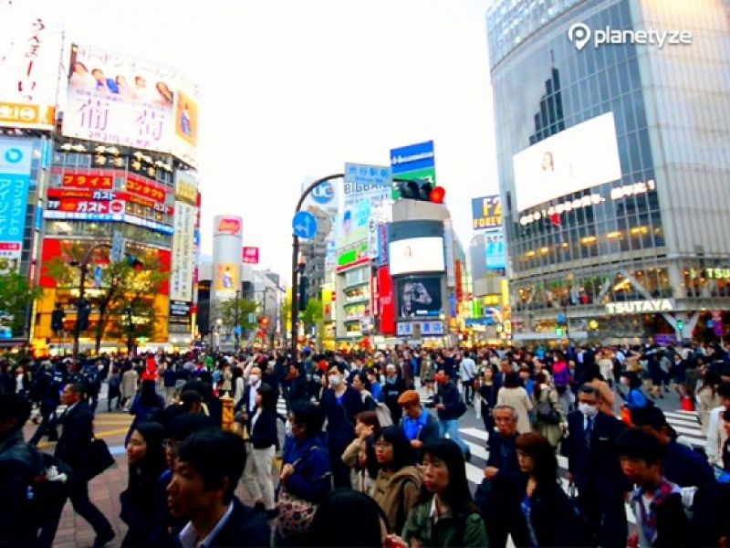 The large scramble pedestrian crossing in Shibuya is another unique tourist spot. People walk into the crossing from all directions and out to other directions. Surprisingly they never bump against each other.