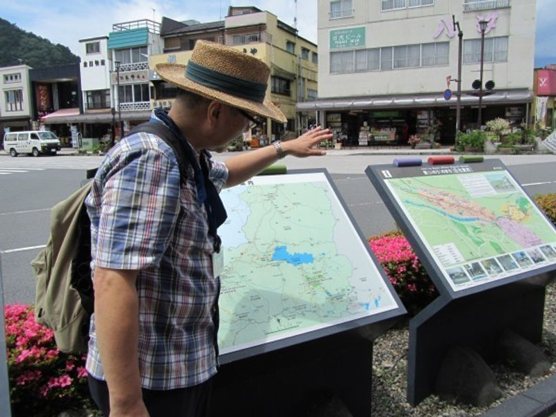 In front of Tobu Nikko station.  I explain where we are going from now on.