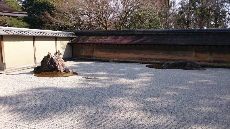 Ryoanji temple  Zen Buddhism temple in Saga area in Kyoto is famous for its dry landscape garden. The garden consists of only fifteen rocks and gravel without trees and water.If you meditate in front of the garden,its simplicity might make you feel more reluxed and refreshed. I'll definitely guide you to the garden once my tour idea to Kyoto is completed.