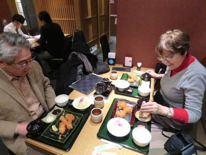 clients enjoy Japanese lunch menu of tempra recipe at some restaurant in the New Marunouchi Bldg , during one day tour of Tokyo.