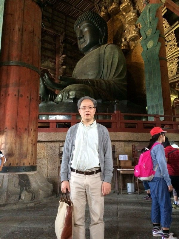 Behind the Great Buddha Statue of the TODAI-JI Temple in Nara am I guiding you.     The merciful expression of the Buddha's face represents the perfect figure of the Supreme Existence.